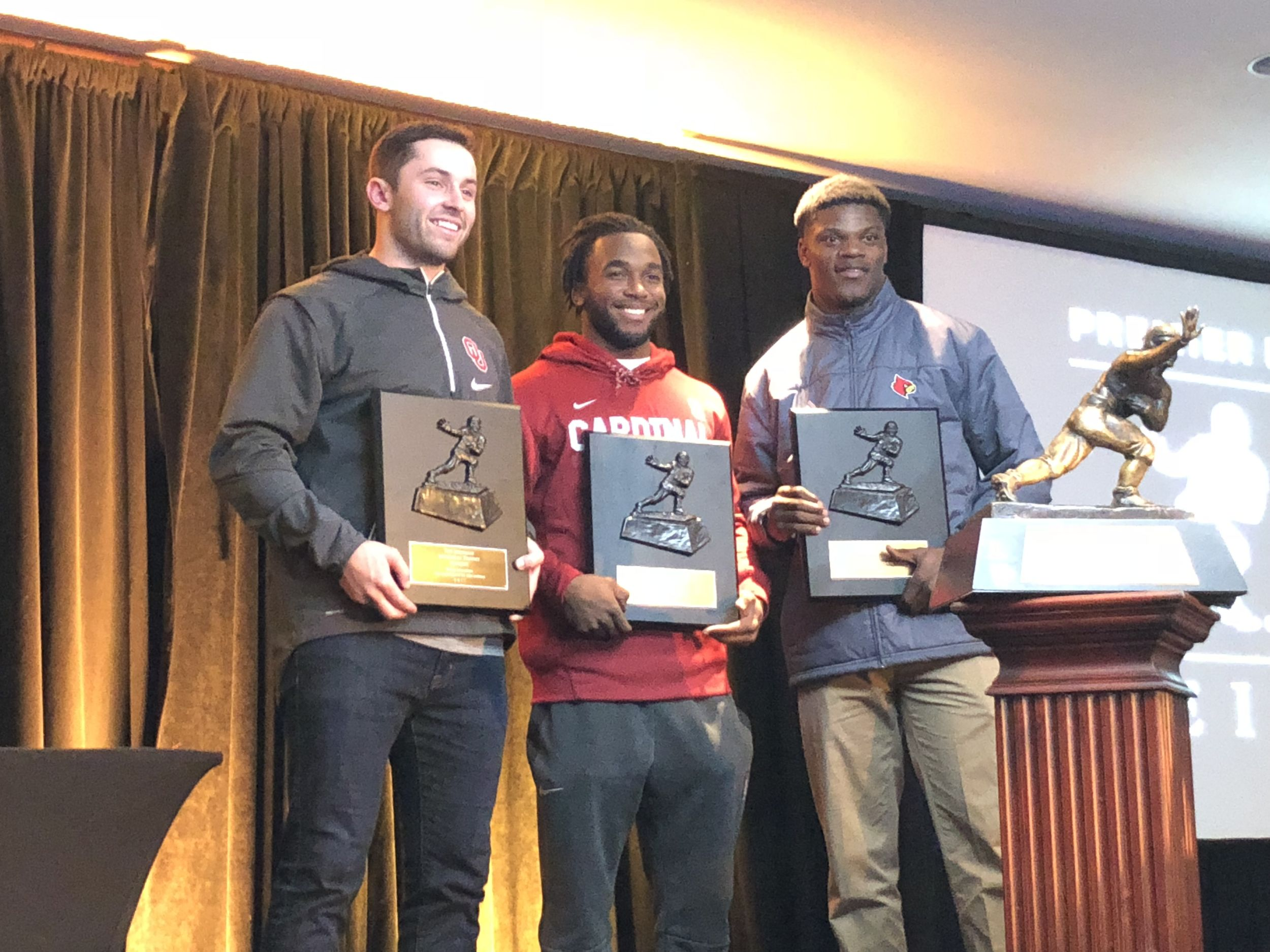 The Heisman finalists with their finalist plaques