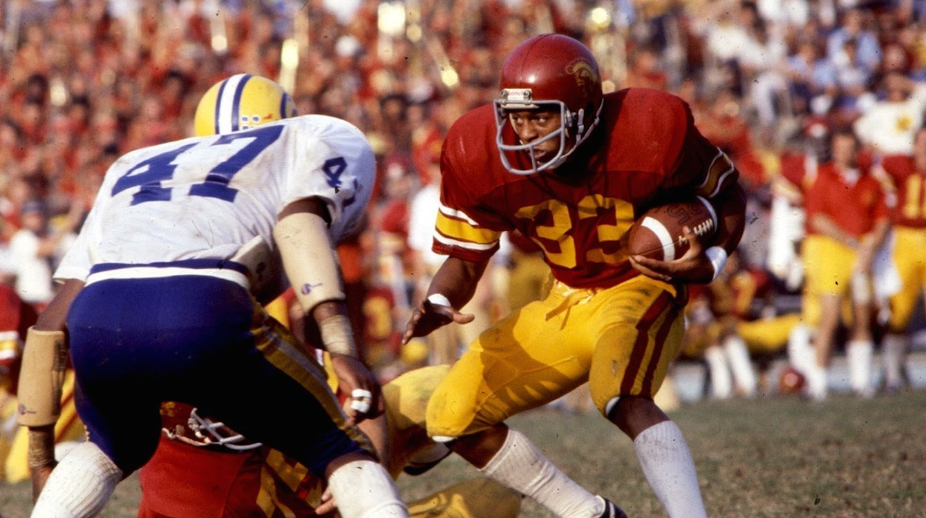 Marcus Allen breaks the 2,000-yard barrier