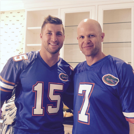 Tim Tebow with Danny Wuerffel in uniform